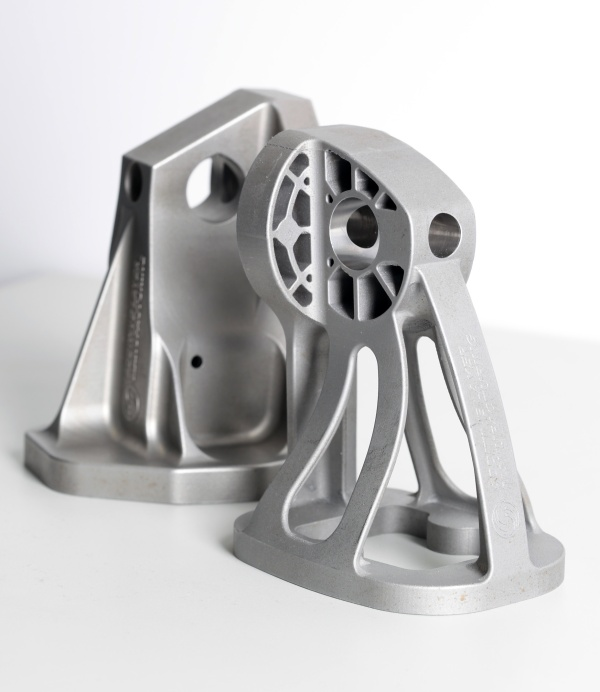 A stainless steel bracket optimized for weight reduction (front) and the traditional cast bracket in the back.
