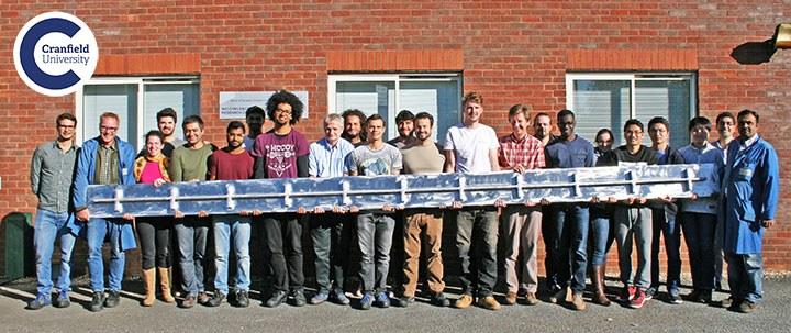 Cranfield graduate students show off largest 3D metal print (photo courtesy of Cranfield University)