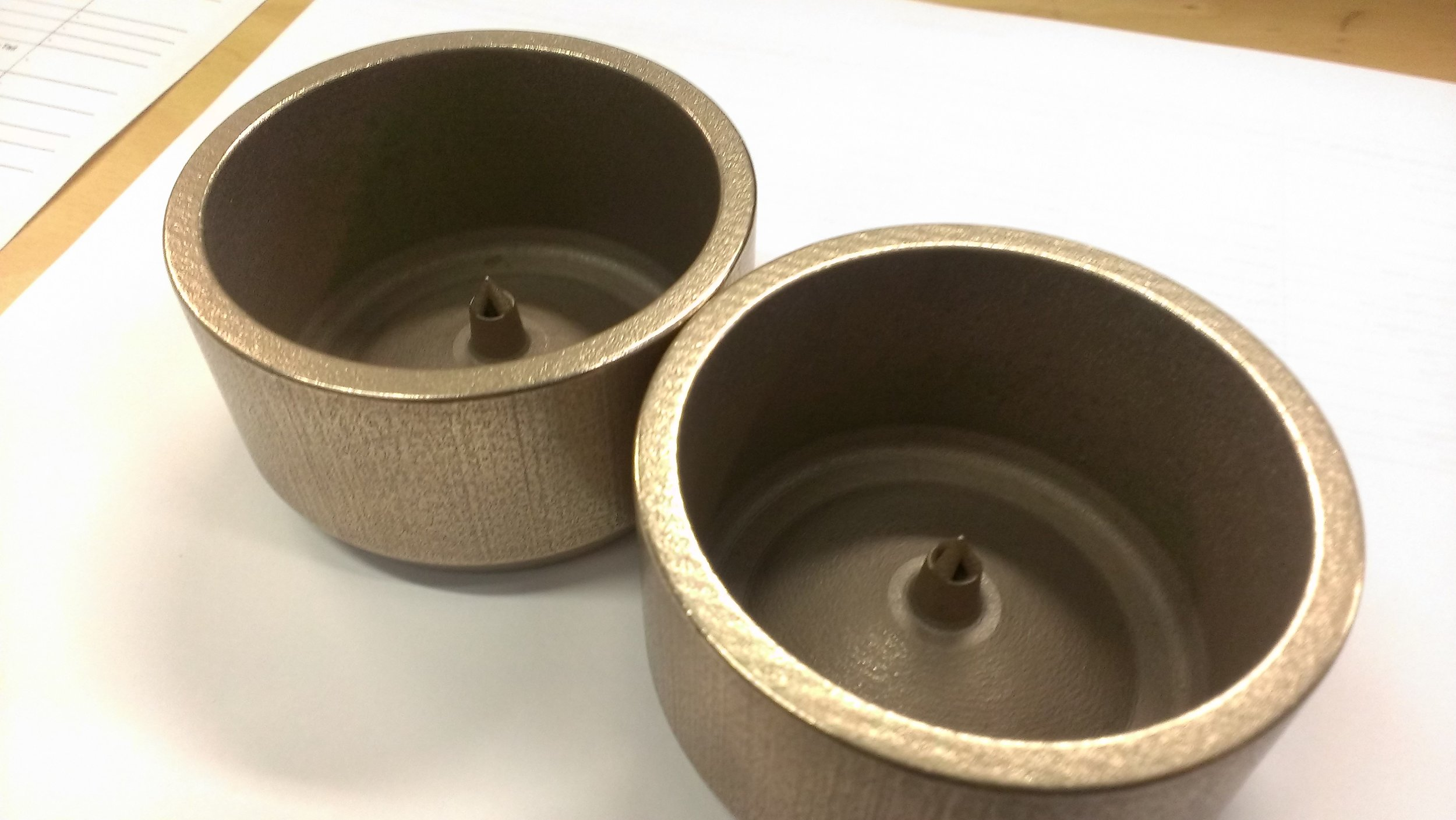 3D printed metal parts made with stainless steel bronze alloy.