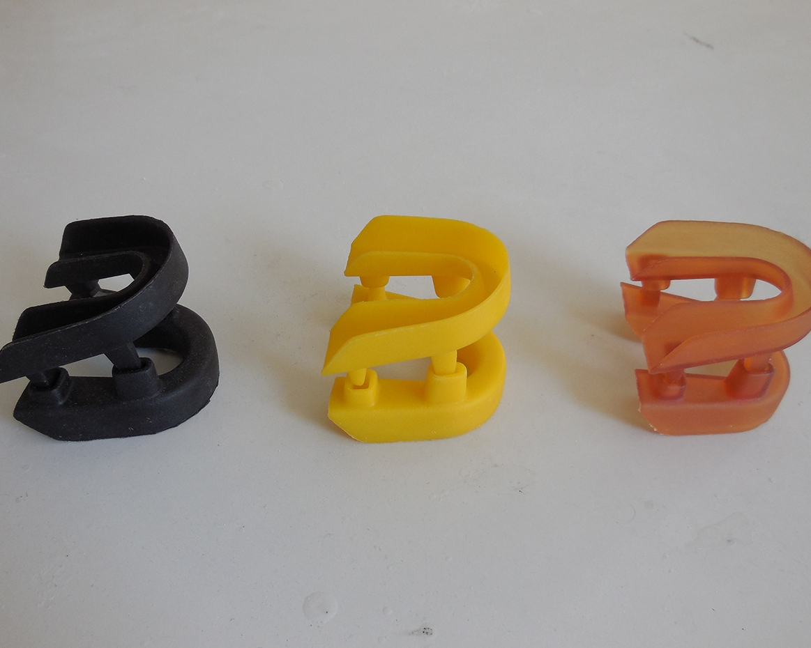 Custom cast mouth guards manufactured by RapidMade using reactive casting.