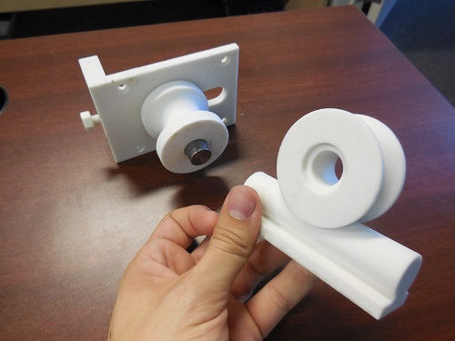 3D printed prototype of a plastic roller to test function and fit.