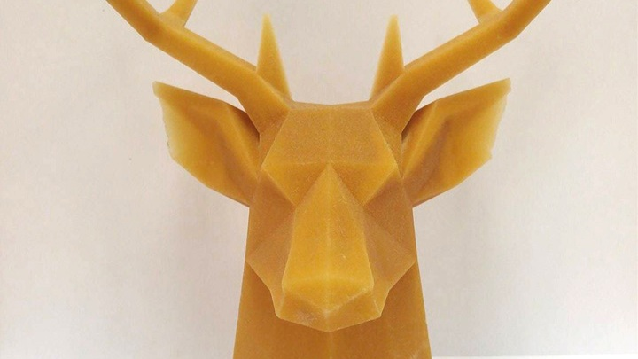 A 3D printed plastic model stag head made with large format printing.