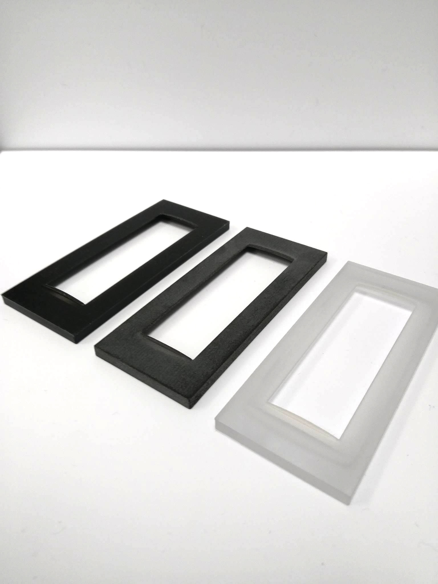 Carbon-filled nylon panels 3D printed with selective laser sintering (SLS).