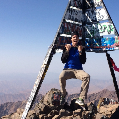 Doing pull-ups on the Toubkal summit marker