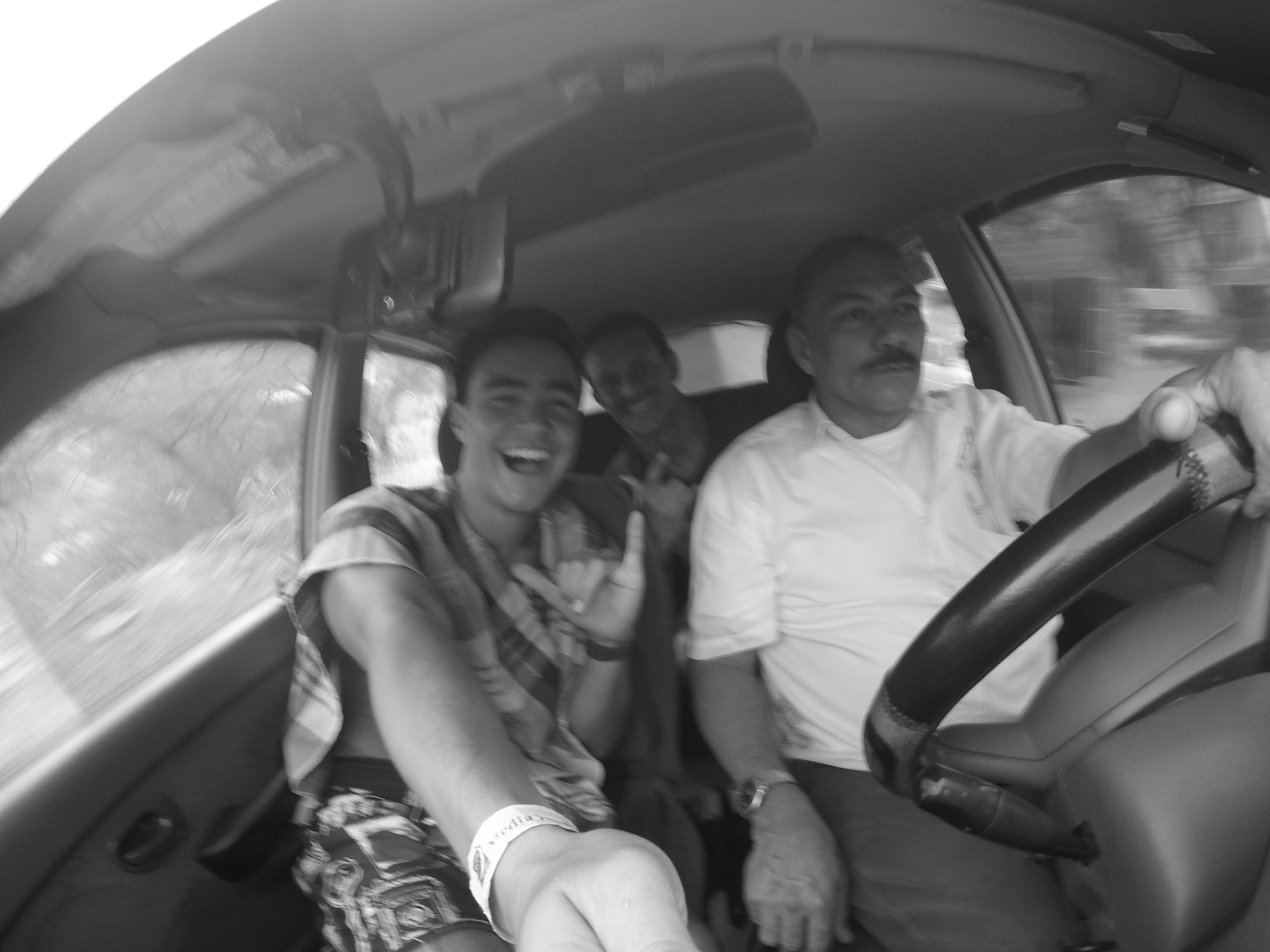 CRAZY TAXI JOURNEYS. I MET A BRAZILIAN BROTHER CALLED DIEGO. TOGETHER WE WENT EXPLORING SOME COASTLINES WITH THIS VERY WITTY TAXI DRIVER. I TOOK THIS SHOT JUST BEFORE WE GOT PULLED OVER AND SEMI DRUG SEARCHED.