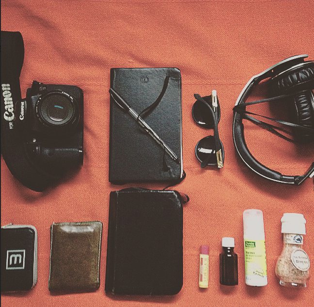 TRAVEL ESSENTIALS - camera, natural deodorant, sea salt, writing materials, leather walllet, headphones, polarized sunnies, bible, burts bees lip balm, camera CF cards.