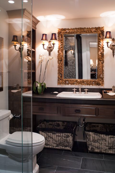 The floating, walnut vanity in this guest ensuite leaves plenty of room for the toile fabric storage baskets below. (Casey Design/Planning Group Inc. - Photo by Ted Yarwood)