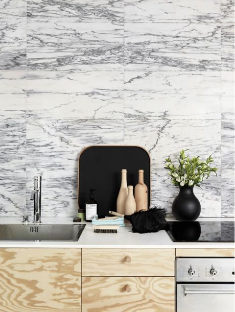 Gorgeous marble wall offset with handsome black accessories creates the drama I love! ( Yellowtrace )