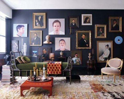 Living room, cozy heaven. Love the portraits! ( Elle Decor ).
