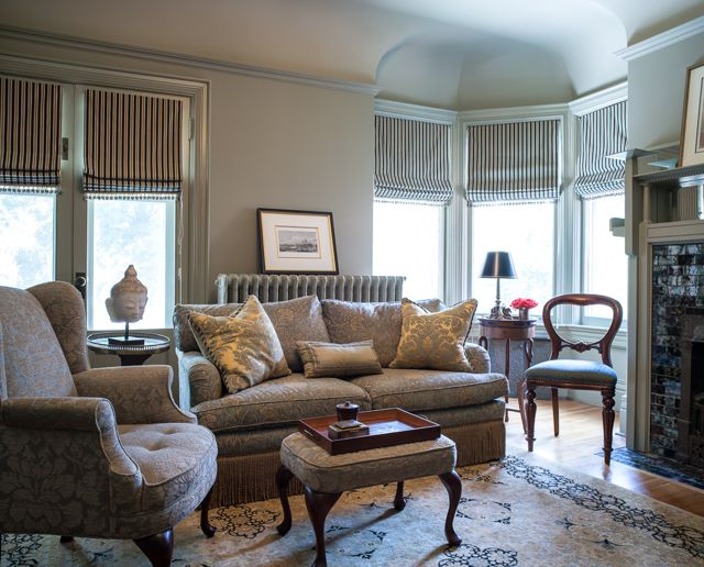 This traditional study has a soft, light-green palette and the striped draperies create a graphic yet warm quality (Casey Design/Planning Group Inc. - Photo by Ted Yarwood).