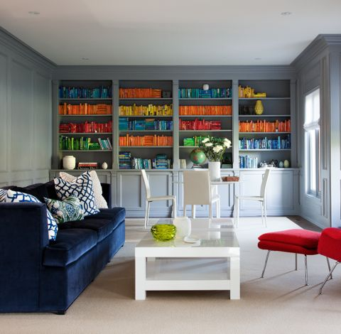 What is more bold than a velvet indigo sofa? We love how playful this room is with the bright penguin books and accessories. (Casey Design/Planning Group Inc. - Photos by Ted Yarwood).