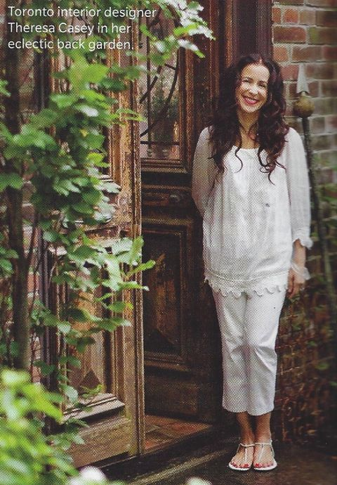 Theresa Casey in the lower courtyard of her eclectic garden.
