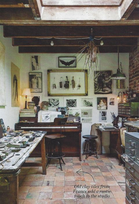 Once a garage used for storage, the studio features exposed brick, salvaged antique French clay tiles and wood beams that create a sense of age and character.