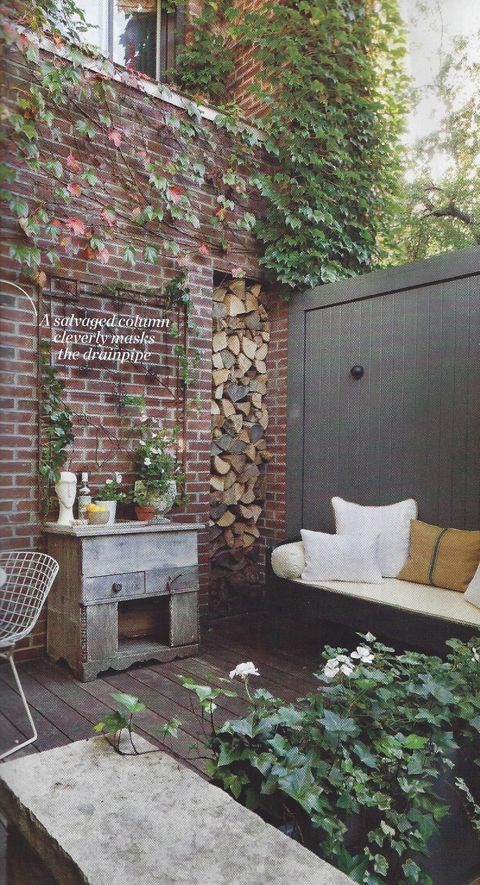 """The end result - a lush, romantic and inspirational courtyard that welcomes many different uses and acts as a """"growing canvas"""" for the designer's ideas and creative experiments."""