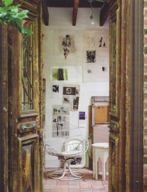 Egyptian Deco doors lead into Theresa's studio from the stone courtyard.
