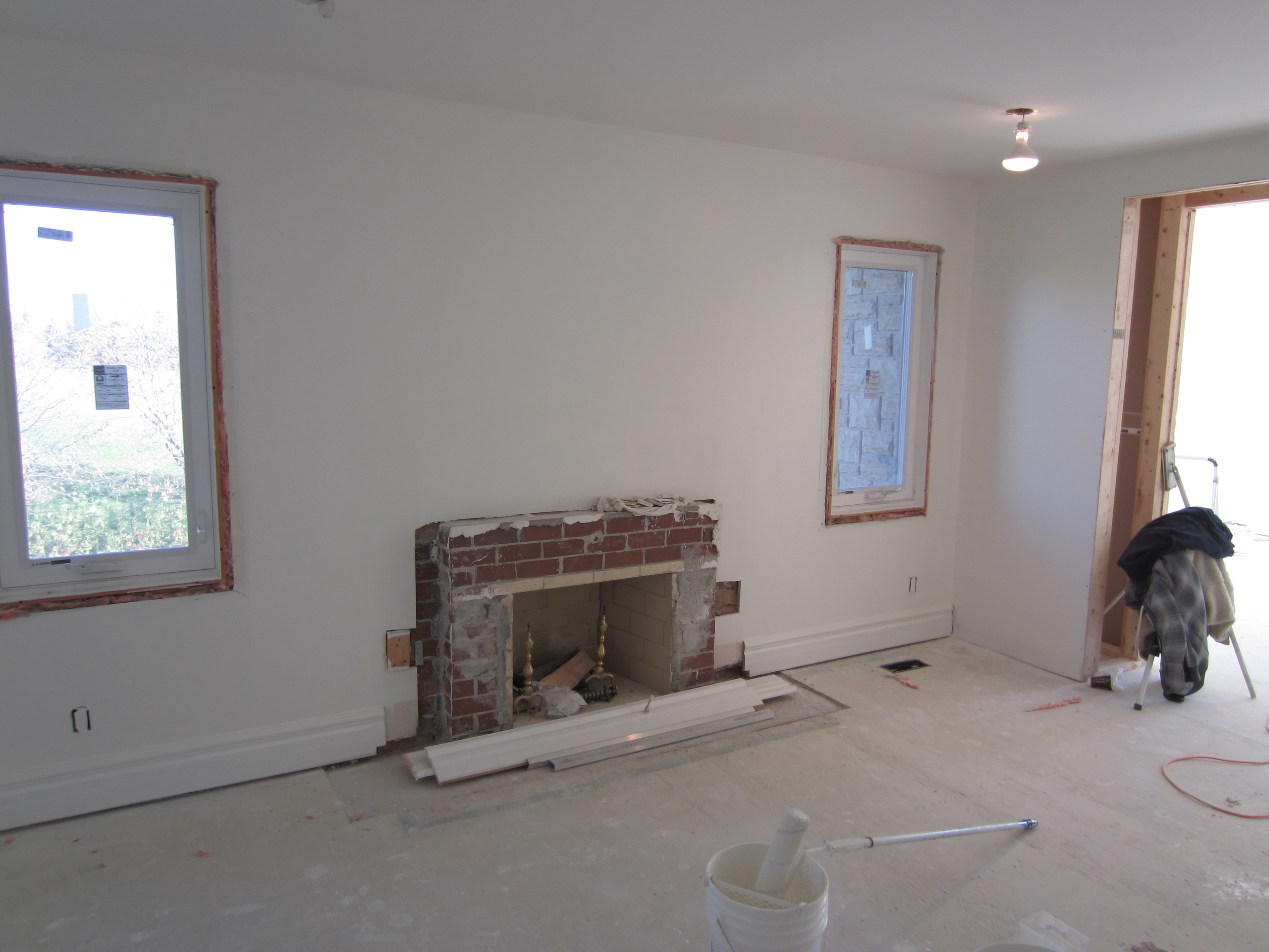The demolition begins as we remove the stone and traditional mantel.