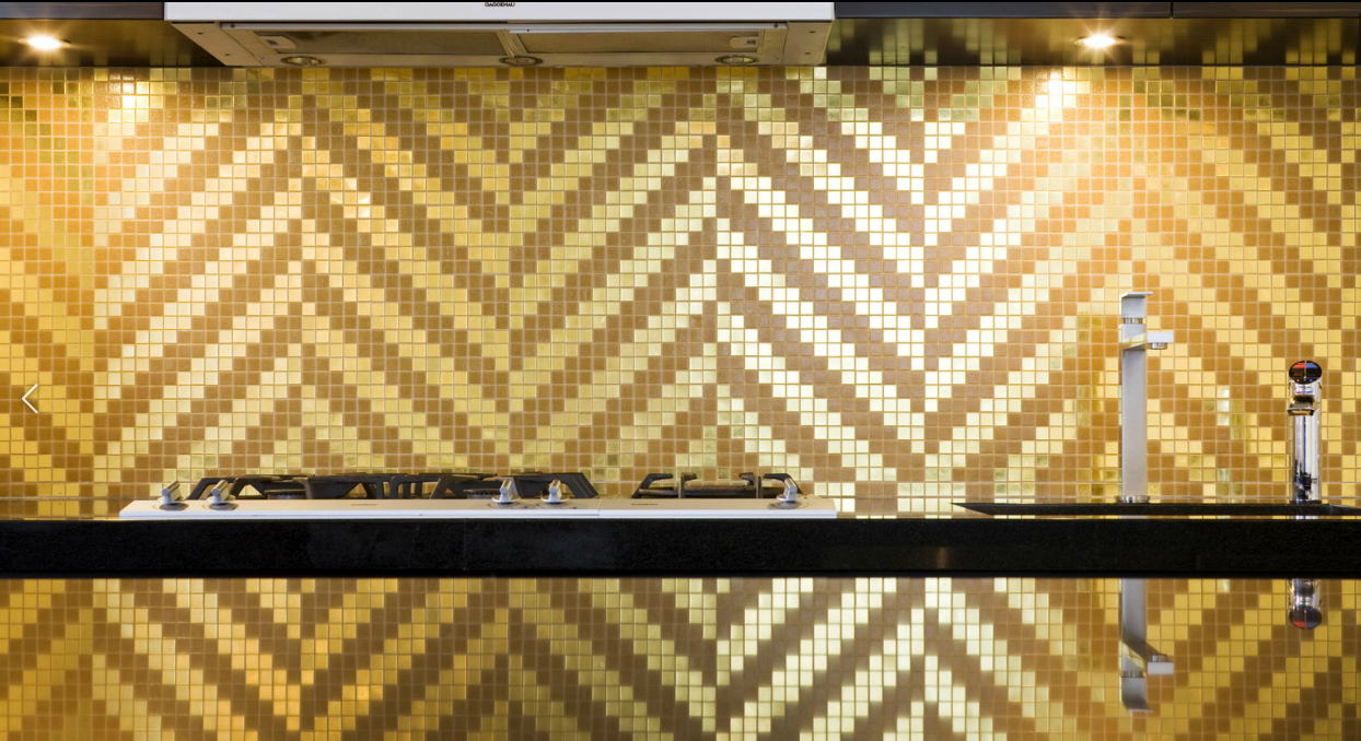 We love the use of pattern and colour in this striking backsplash! ( Bisazza )