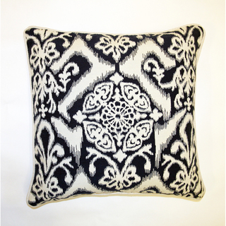 Accents of ikat in a black and white palette is a subtle way to introduce this pattern into a space. ( Jar Designs )