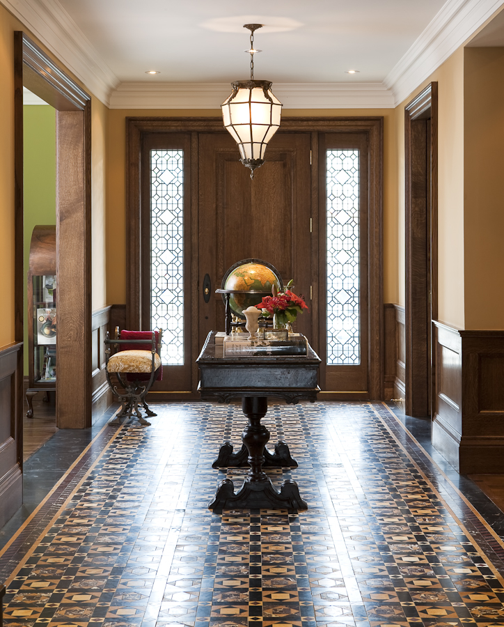 This entryway makes a strong impression with its intricate marble mosaic tile patterns. (Casey Design/Planning Group Inc. - photograph by Ted Yarwood)