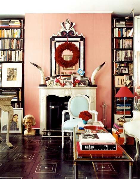 Red and black accents against a dusty pink wall can make this space feel anything but boring! ( Paul Costello )
