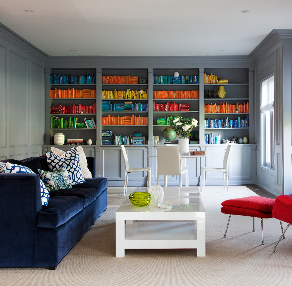 An at-home library requires space for reading and working. Based on the clients' common activities, this dual purpose space has two zones, a table for work / study, and a seating area for relaxing. (Casey Design / Planning Group Inc.- photograph by Donna Griffiths)