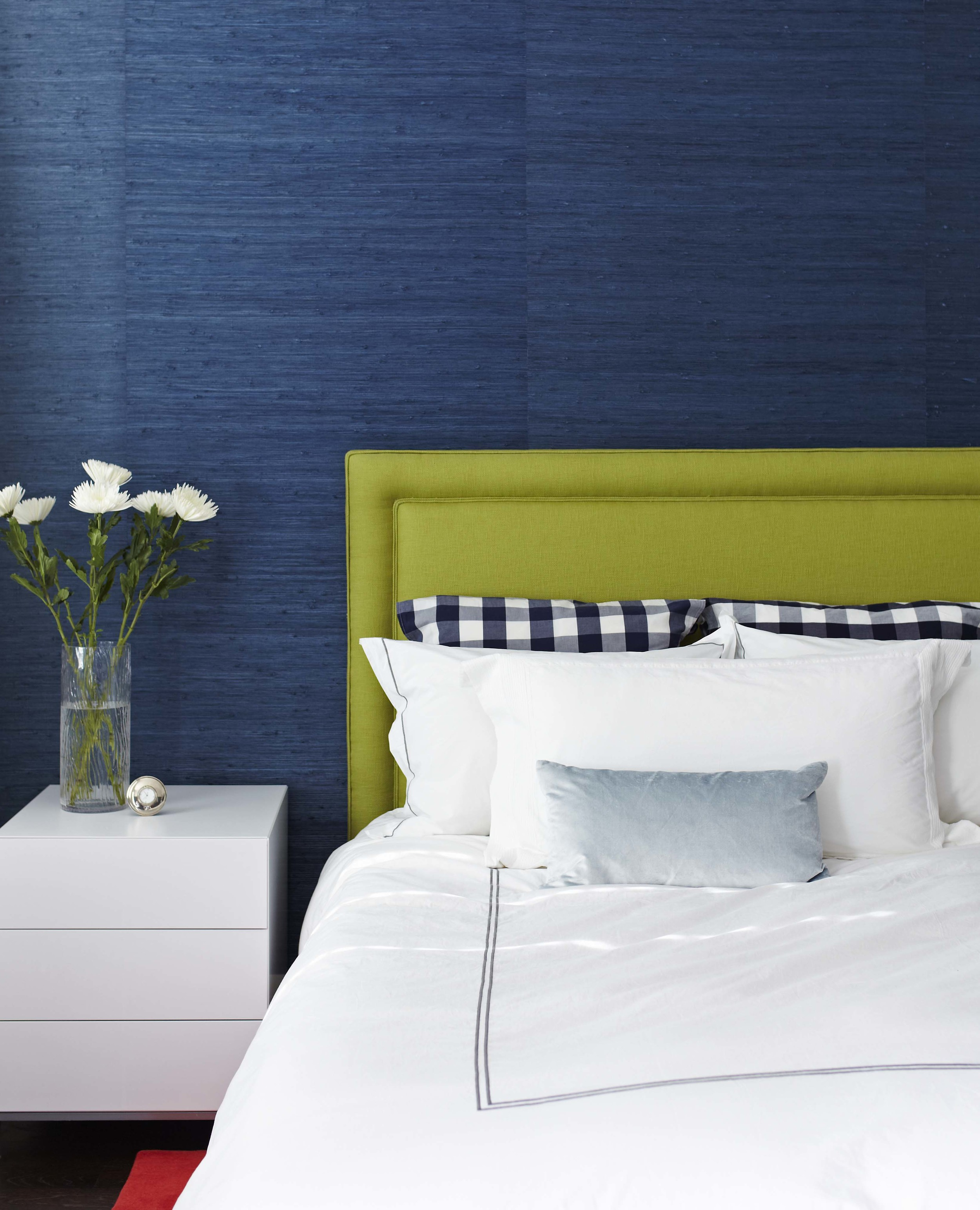 Love the Hastings Bed we used here combined with bold blue textured wallpaper and a lime coloured headboard and the white accents- together, they create a crisp and contemporary master bedroom. (Casey Design / Planning Group Inc. - photograph by Donna Griffith