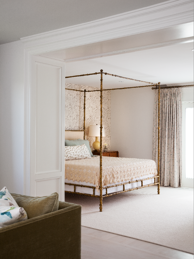 A brass bamboo-inspired 4-poster bed anchors the space and complements the surrounding pastel and creme accents. (Casey Design / Planning Group Inc. - photograph by Donna Griffith)