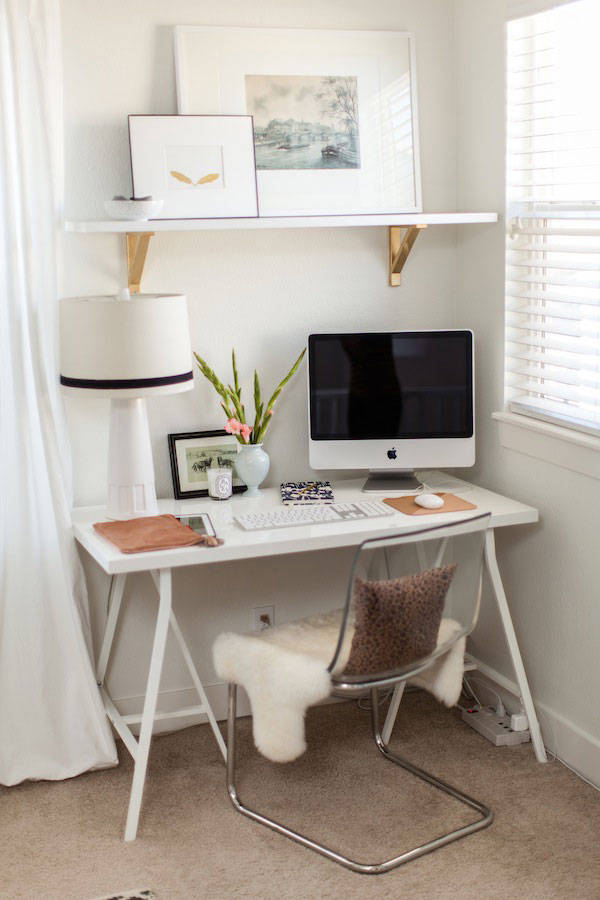 This small home office is an efficient use of space in a master suite. Keeping furniture and accessories neutral allows the office to be tucked away from view when needed ( Harper's Bazaar )