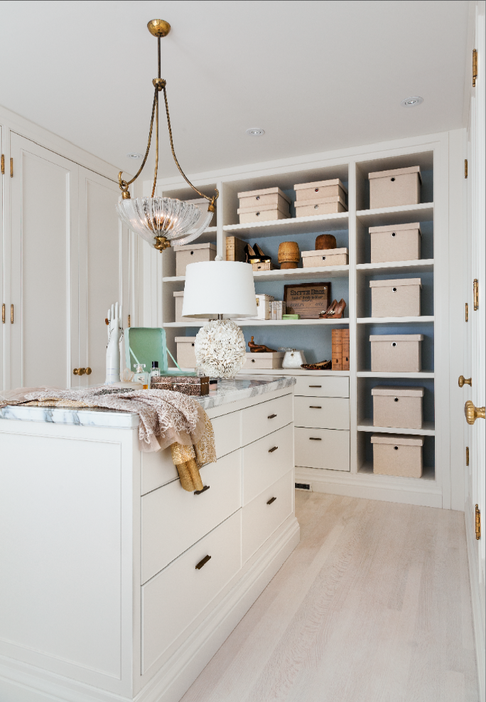 When spaces allow, an island in a master closet creates plenty of storage space for accessories and jewellery. We love the brass hardware against the white millwork. So crisp and fresh! (Casey Design / Planning Group Inc. - photograph by Donna Griffith)