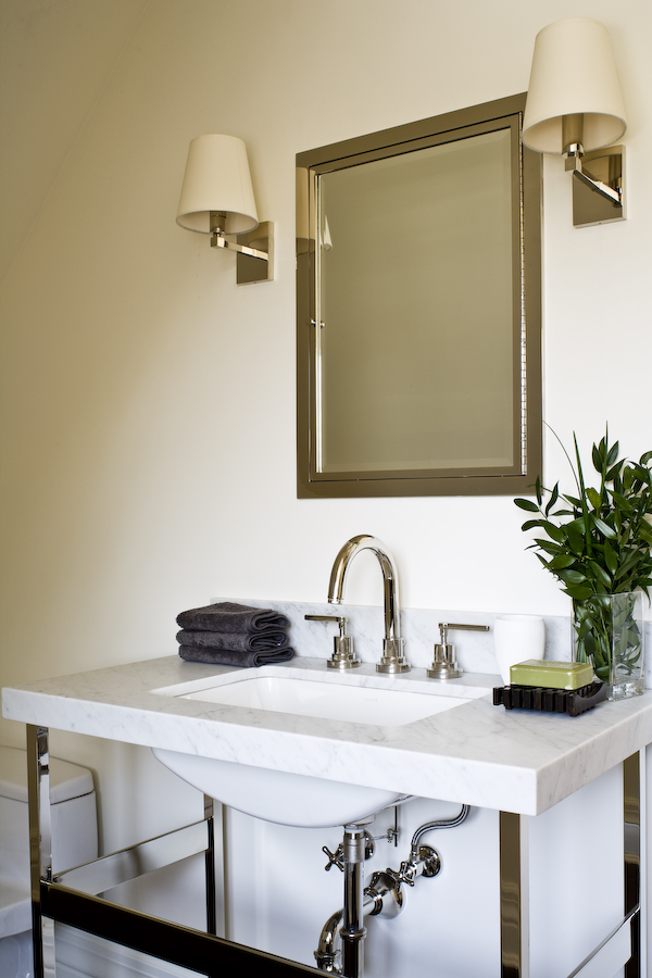 This Waterworks open sink pedestal  gives our client's powder room  character and the clean lines and  white marble appeal to both the husband and the wife - so not too feminine or masculine but the perfect mix.  (Photography by Ted Yarwood)