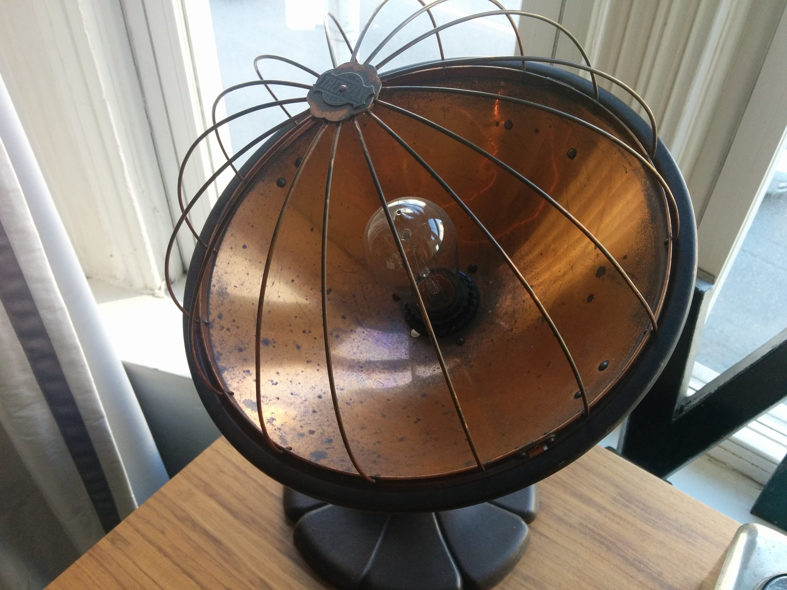 This vintage lamp is a rare find and definitely an eye-catcher because of it's unique form.
