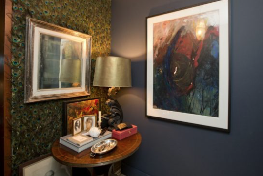 Meanwhile, the peacock-feathered entry, hand-applied by Casey herself, sets the tone for Casey's uniquely artful and atmospheric Toronto home.