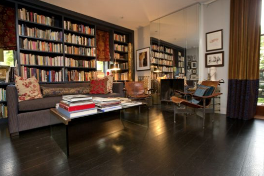 Casey's richly layered, exquisitely appointed Deco-inspired living room, full of books and significant antique furnishings demonstrates her uniquely evocative hand at interiors, the very quality clients seek her out for.