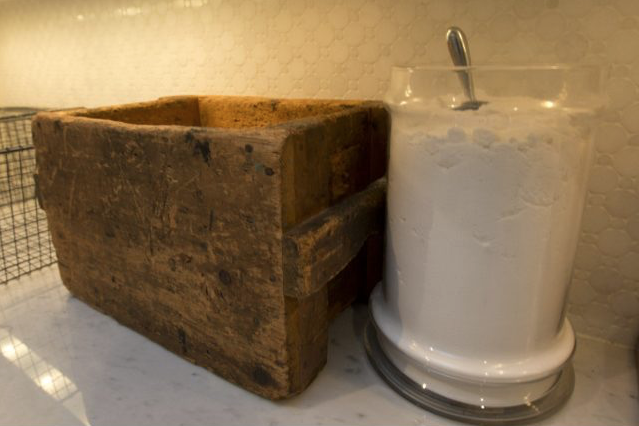 A collection of wooden boxes and old apothecary jars hold such evocative reminders of an old laundry as wooden clothespegs and vintage buttons alongside simple white laundry soap in a glass dispensary with a metal scoop, all of which Casey has sourced on her regular flea market jaunts.