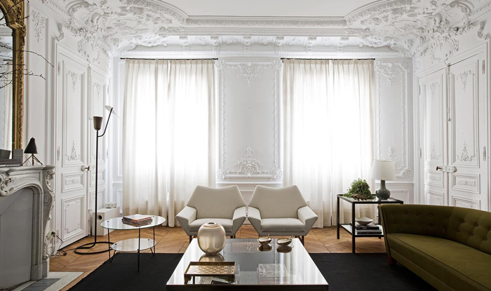 astonishing-interior-design-luxurious-living-room-with-white-walls-interior-decoration-wooden-floor-dilegkapi-two-white-chairs-green-sofa-and-fireplac.jpg
