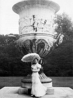 Queen Elizabeth in front of urn by Sir Cecil Beaton .jpg