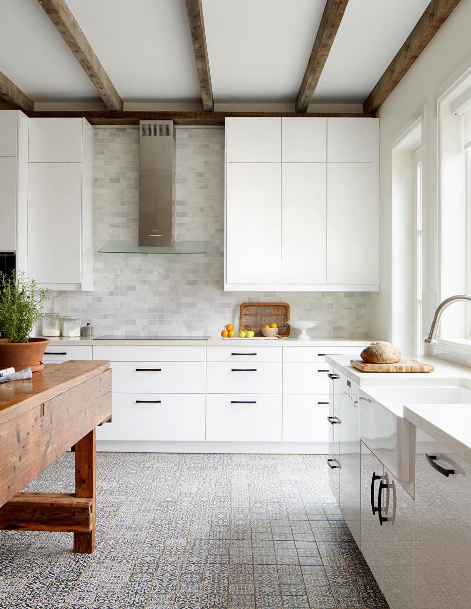 Vintage inspired floor tiles add to the modern chic farmhouse vibe.