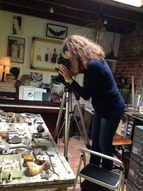 Behind the scenes in Theresa's studio, Donna works to get the perfect angle