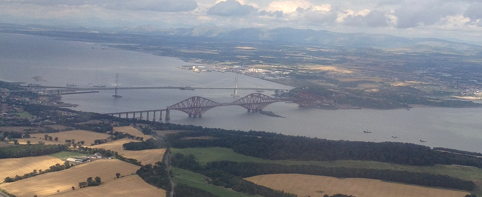 The Forth Rail and Road Bridges banking out of Edinburgh airport