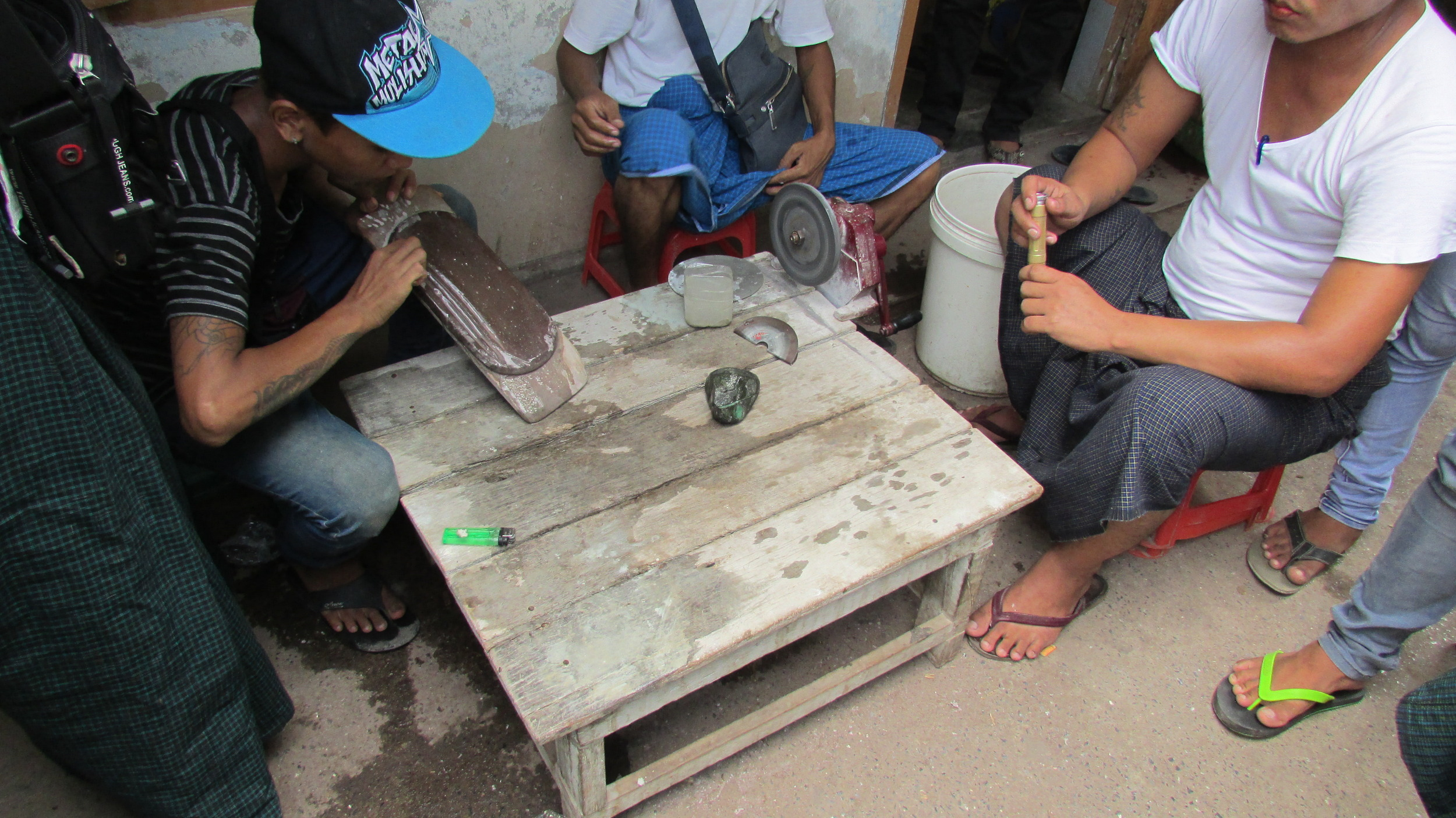 Men's feet at the jade market in Mandalay.