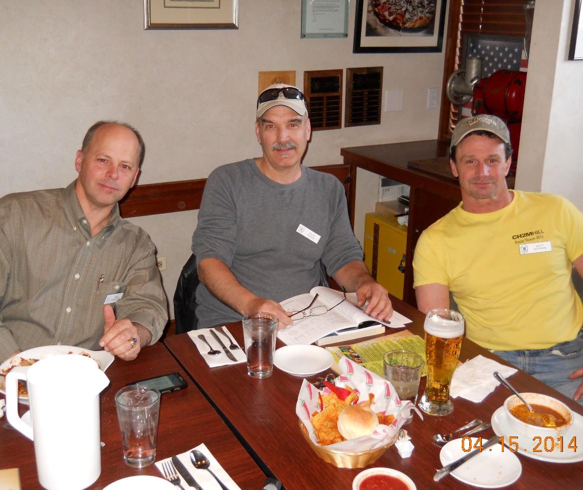 Mark Poindexter, Kevin Nadeau and Hoyt Sutphin enjoy a beer and dinner