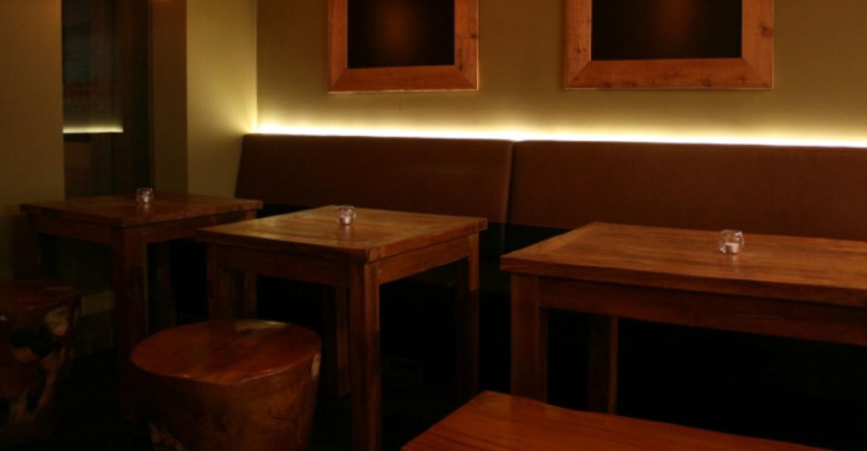 Copy of Segovia Tapas restaurant in winnipeg. Furniture. Sculpted Teak Root Round Stools