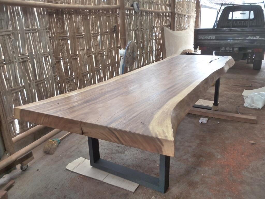 Live edge dining table with metal base. Modern furniture winnipeg.