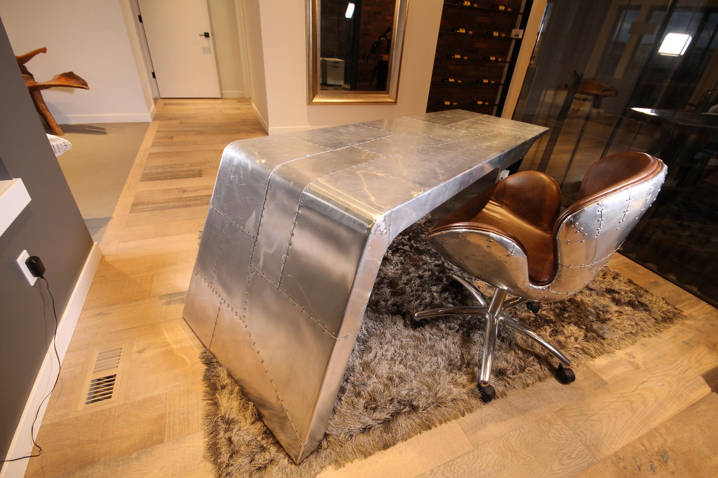 Old tobacco aviator office desk and chair, artista show home. Blue Moon Furniture. Luxury furniture winnipeg.JPG