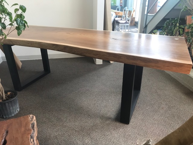 thick live edge dining table in winnipeg. Iron legs on a wood table.jpg