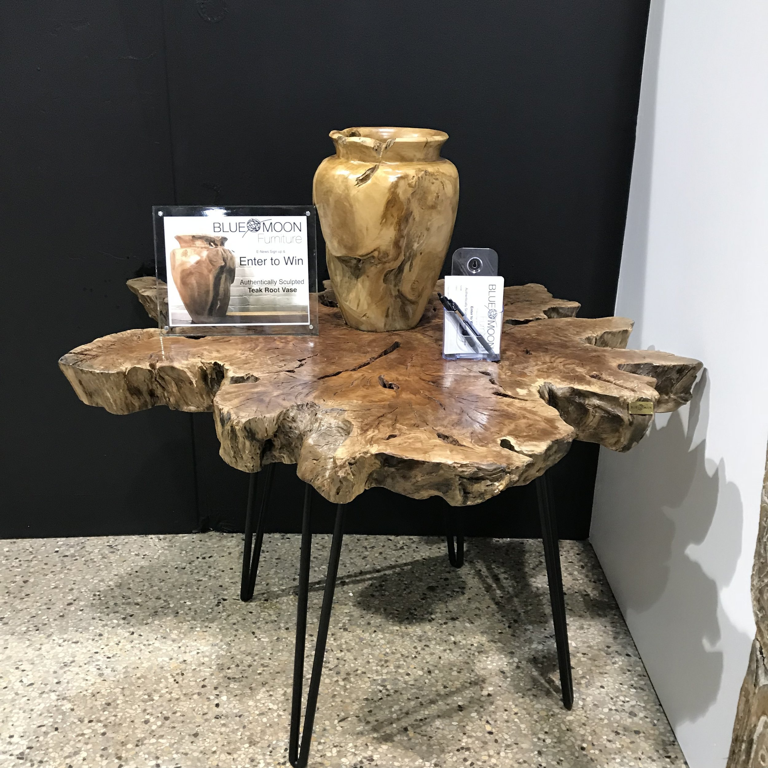 Blue Moon Furniture store in Winnipeg. Exotic Lychee wood authentically sculpted single slice table.JPG