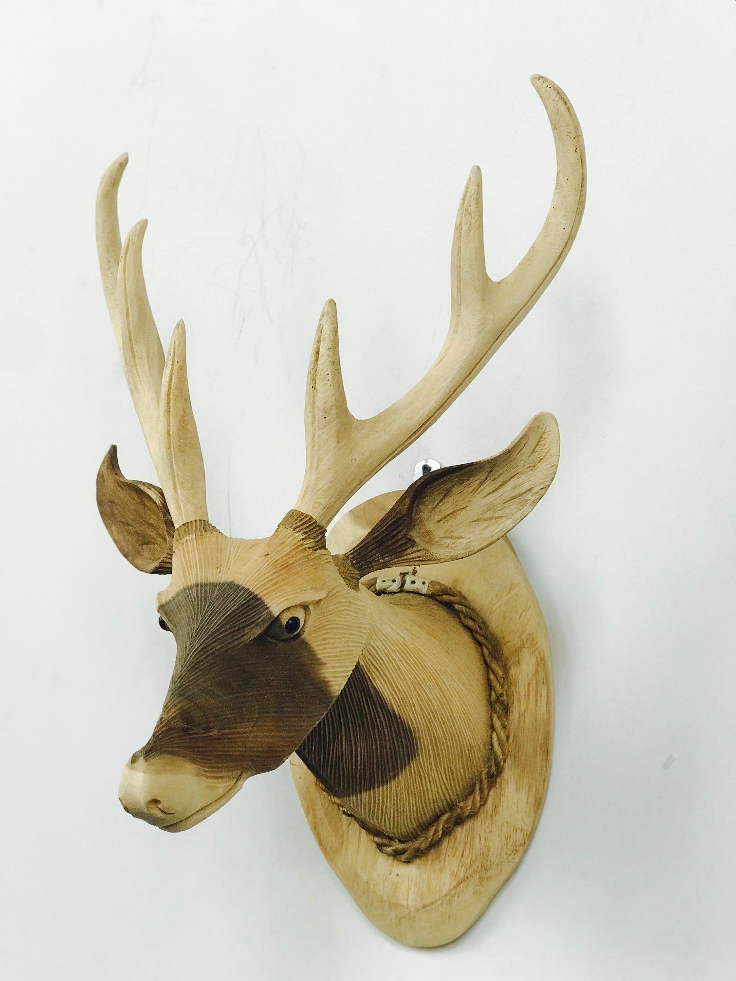 Rose wood deer head sculpture. blue moon furniture store in winnipeg.jpg