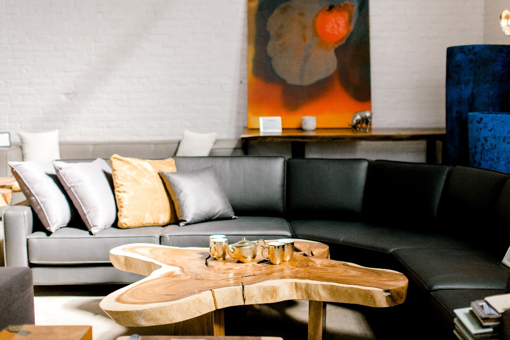 winnipeg parade of homes. leather sectional. free form coffee table. live edge coffee table.jpg