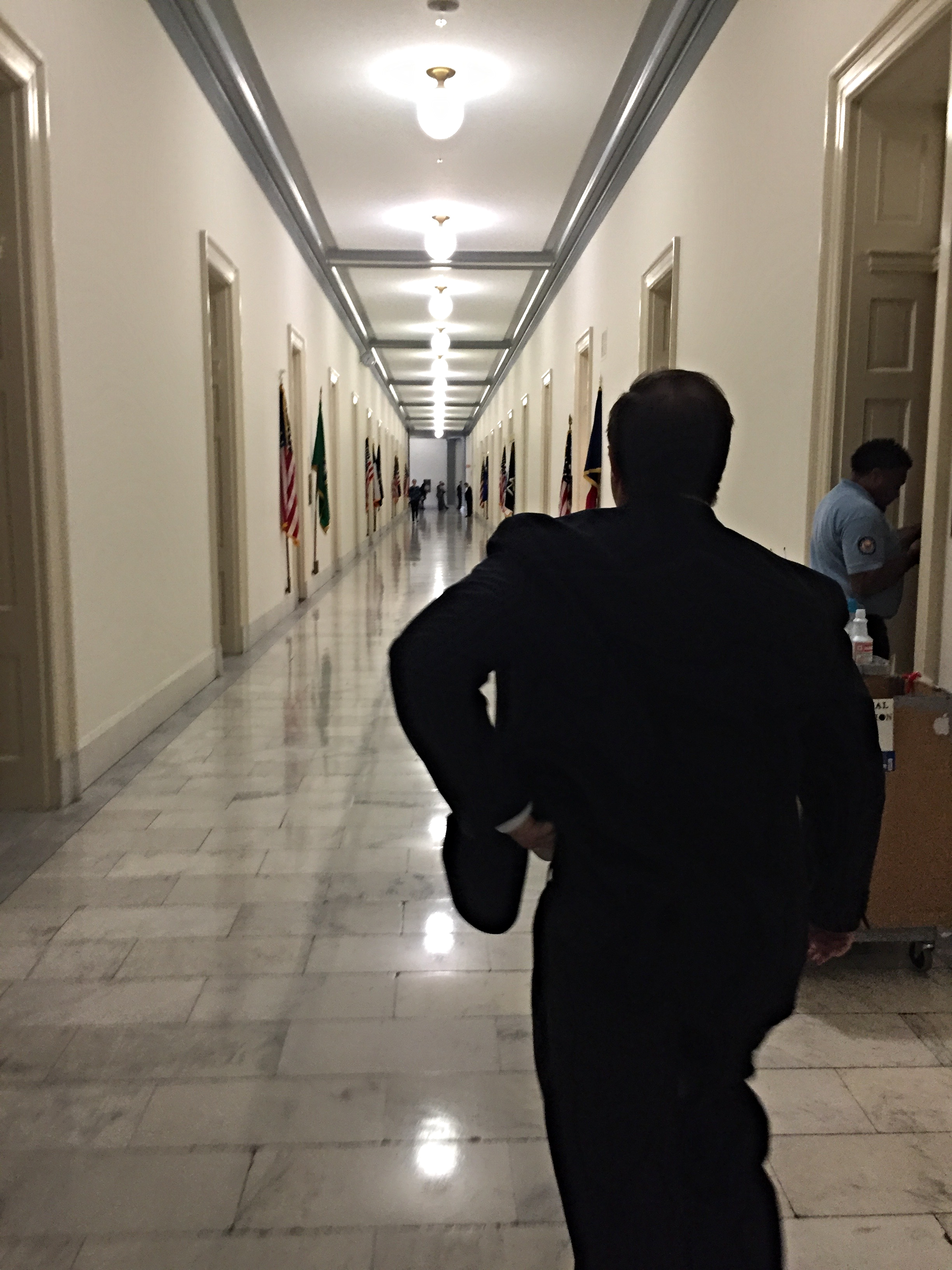 A legislator walks down the halls of the Cannon House Office Building.