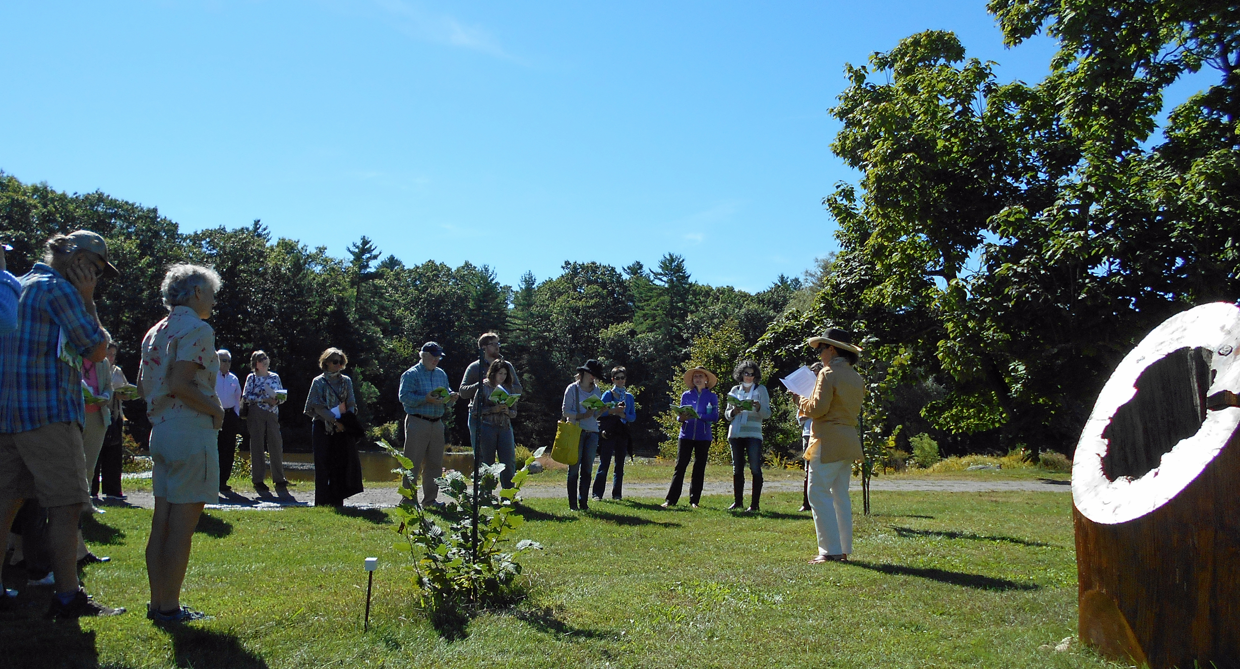 Linda Fialkoff reading her poemat the2014 Plein Air Poetry Walk